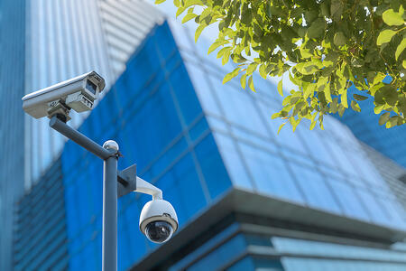 Digital video surveillance cameras outside a professional building