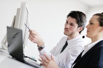 Man training woman at computer