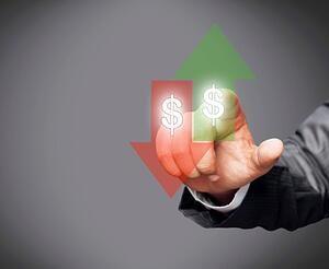 Image of a red arrow pointing down and a green arrow pointing up. Both arrows have dollar signs in them. There is a hand pointing at the green arrow from behind.
